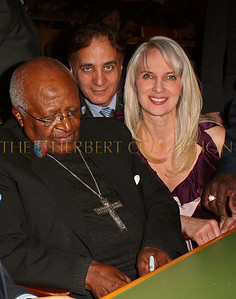 NEW YORK - MARCH 17:   Archbishop Emeritus Desmond Tutu, James Cavello and Charity Consultant Sara Herbert-Galloway (Cavello and Galloway are both on the Board of The Worldwide Childrens Foundation of NY) attend on stage at the MDG Awards global launch event at the United Nations building on March 17, 2009 in New York City.  (Photo by Steve Mack/S.D. Mack Pictures) *** Local Caption *** Francis Lorenzo; Desmond Tutu; James Cavello; Sara Herbert-Galloway
