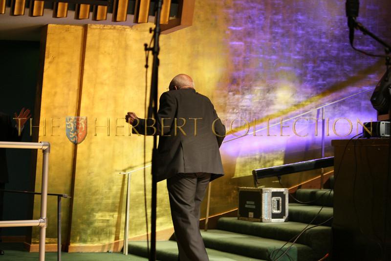 Desmond Tutu dancing off stage