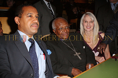 NEW YORK - MARCH 17:  Ambassador Francis Lorenzo, Permanent Mission of the Dominican Republic to the UN, Archbishop Emeritus Desmond Tutu, Charity Consultant Sara Herbert-Galloway at the MDG Awards global launch event at the United Nations building on March 17, 2009 in New York City.  (Photo by Steve Mack/S.D. Mack Pictures) *** Local Caption *** Francis Lorenzo; Desmond Tutu; James Cavello; Sara Herbert-Galloway