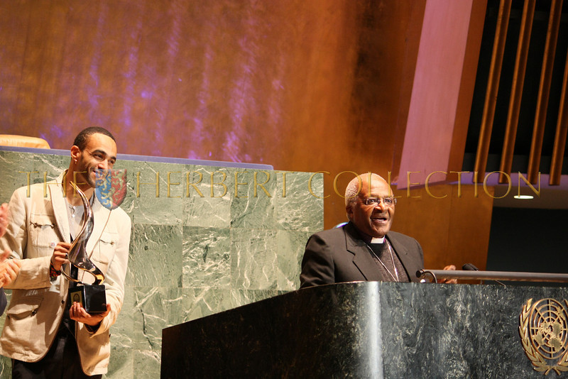 Guy Sol presenting Archbishop Emeritus Desmond Tutu with award