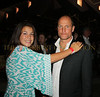 Proud daughter Deni Harrelson gives dad Woody Harrelson a hug