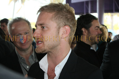Ben Foster being interviewed as Gary Springer of Springer Associates over sees the red carpet