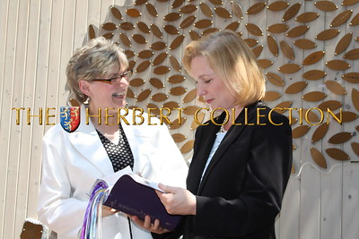 Deborah Jones, Director of The Bowery Mission's Women's Center presents Senator Kristen Gillibrand with a bible from the Mission with bookmarks from each resident