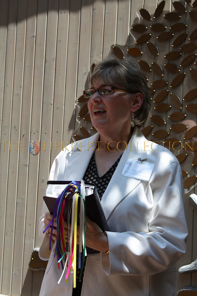 Deborah Jones holding BIble that has been bookmarked by residents of the Mission