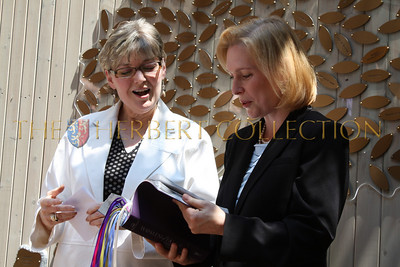 Deborah Jones, Director of The Bowery Mission's Women's Center presents Senator Kirsten Gillibrand with a bible from the Mission with bookmarks from each resident