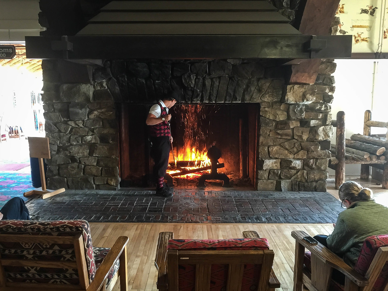Stoking the fire in the lodge