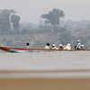 local women arriving to gather snails, Koh Preah, Mekong River, Cambodia