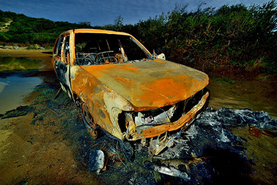 Burned out car behind Calvert's Beach