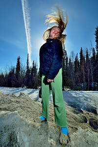 Jacq flinging her hair, with a jet contrail in the background