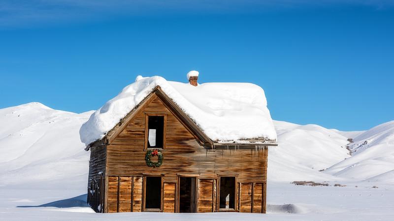 Winter homestead with wreath over door