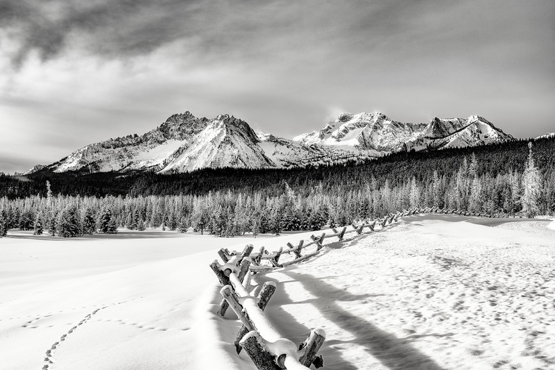 Classic le fence in winter with Sawtooth mountains