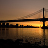 Manhattan bridge sunrise with sun star