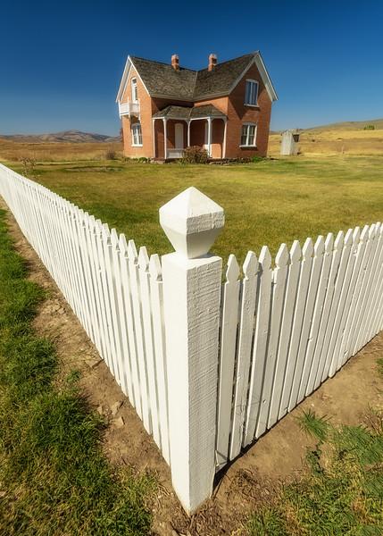 Brick home on a high rural prairie in the Idaho farmland