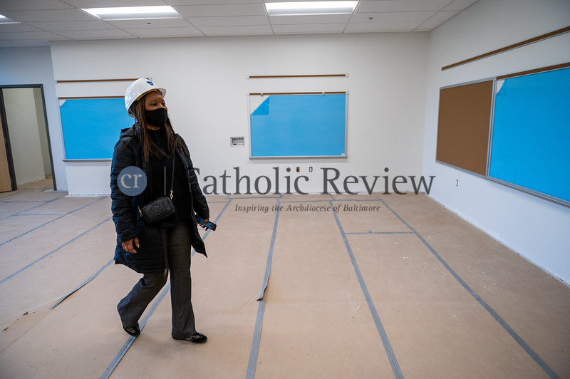Alisha Jordan, principal of Mother Mary Lange School, inspect one of the 26 educational spaces during a construction update visit. (Kevin J. Parks, CR Staff)