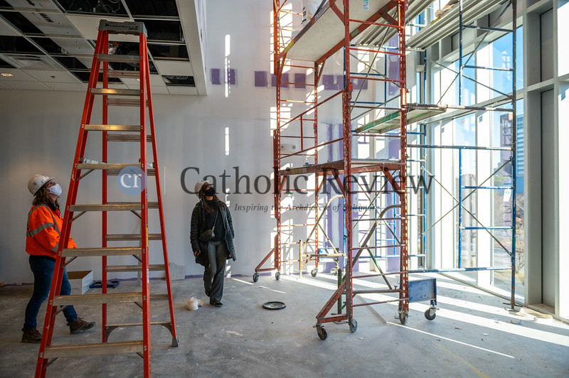 Alisha Jordan, center, principal of Mother Mary Lange School, inspect the chapel construction at the West Baltimore school. (Kevin J. Parks, CR Staff)