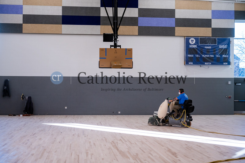 Floor sanding and preparation is underway in the full-size gym at the Mother Mary Lange School. (Kevin J. Parks/CR Staff)