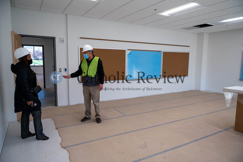 Alisha Jordan, left, principal of Mother Mary Lange School, gets a construction update in one of the classrooms that will welcome students in fall 2021. (Kevin J. Parks, CR Staff)
