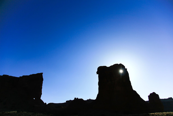 """The Eye in the Rock"" I call this... riding through ""The Arches"" near Moab, a glare appeared, this is the results. A couple silhouettes in the rocks also."