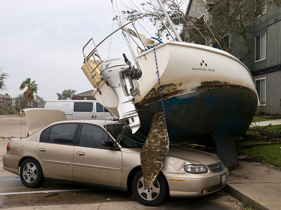 Boat damage was intense. This shot looked so unreal, almost man-made. To witness a boat sitting on top of a car like this was shocking. One can feel the power of the hurricane from this image alone. I was capturing history in the making.  Olympus E3, 12-60mm SWD - F5, 1/320s