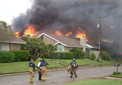 House fires were a common sight during Hurricane Ike. One thing that did surprise me, whilst driving around hurricane damaged areas, was the number of property fires. I caught up with this one not long after it had started. Thankfully the residents got out in time. Fire fighters were running around like headless chickens since they had no water, ironically so close to the sea. They have a thankless job and are the true heroes in natural disasters and emergency management such as this.  Olympus E3, 12-60mm SWD - F5.6, 1/160s