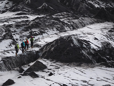 Glacier, Solheimajokull. Olympus E-M1, 75-300mm m4/3 lens. F5.9, 1/60s, ISO 200. Its not all about wide. Zoom in on your subject for a detailed composition. Walkers give a good perspective to the glacier. A combination of the bright ice and snow with the dark volcanic rock make a testing exposure on this 179mm focal length shot. Camera handled it well.