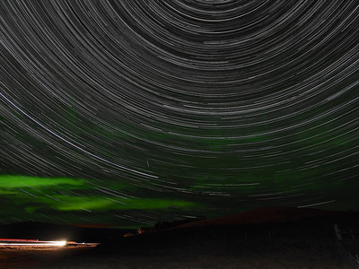 StarTrail over Solheimahjaleiga, 24km west of Vik. Olympus E-M5, 12mm m4/3 lens. F3.5, 15s (1600 No exposures), ISO 320. Taking advantage of the clear black & pollution free skies in a remote location in South Iceland I set up the E-M5 (with battery pack) to shoot an all night startrail. Sadly I never had the battery pack for the E-M1. Still, this resulting composite of over 1500 images is fantastic. Very clean and the bonus of minor aurora during the shoot adds some drama to the composition. The m4/3 lenses in low light shoots such as these I am increasing finding are so good and light sensitive. They allow lower ISO levels and equal or lower exposure times  with far superior quality output than the E5. The composition was based around polaris (north star) which gives the swirly star effect (Earth's rotation). Bright lights bottom left passing vehicle.....only 1 all night!