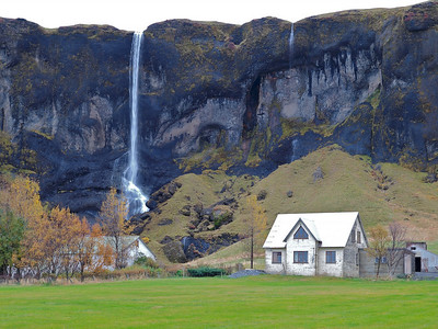 Passing another waterfall, somewhere in south Iceland. This house was a nightmare to expose, painted entirely white all over.