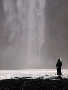 Skógafoss, is situated in the south of Iceland at the cliffs of the former coastline. The coastline has receded into the sea (it is now about 5 km from Skógar). The stunningly majestic cliffs lie parallel to the coast over hundreds of kilometers, creating together with some mountains a clear border between the Lowlands and the Highlands of Iceland.  Skógafoss is one of the biggest and most beautiful waterfalls of the country with a width of 25 meters and a drop of 60 meters. Due to the amount of spray the waterfall consistently produces, a single or double rainbow is normally visible on sunny days.  Not whilst I was there mind!  According to legend, the first Viking settler in the area buried a treasure in a cave behind the waterfall. A local boy found the chest years later, but was only able to grasp the ring on the side of the chest before it disappeared again......I never found it, but got some great images :) Olympus E3, 12-60mm