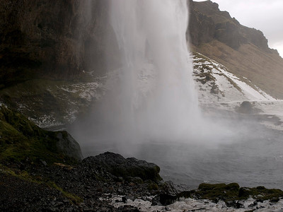 Seljalandsfoss is one of the most famous waterfalls of Iceland. It is very picturesque and situated between Selfoss and Skógafoss.This waterfall of the river Seljalandsá drops 60 metres (200 ft) over the cliffs of the former coastline.   It is possible to walk behind the waterfall albeit via a dodgy  icy, narrow track. Well worth it though as the view close up is breathtaking. Inside the falls. Olympus E3 12-60mm.