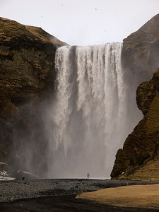Skógafoss, is situated in the south of Iceland at the cliffs of the former coastline. The coastline has receded into the sea (it is now about 5 km from Skógar). The stunningly majestic cliffs lie parallel to the coast over hundreds of kilometers, creating together with some mountains a clear border between the Lowlands and the Highlands of Iceland.  Skógafoss is one of the biggest and most beautiful waterfalls of the country with a width of 25 meters and a drop of 60 meters. Due to the amount of spray the waterfall consistently produces, a single or double rainbow is normally visible on sunny days.  Not whilst I was there mind!  According to legend, the first Viking settler in the area buried a treasure in a cave behind the waterfall. A local boy found the chest years later, but was only able to grasp the ring on the side of the chest before it disappeared again......I never found it, but got some great images :)  That person right at the base really shows the scale of this thing. Olympus E3, 12-60mm