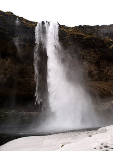 Seljalandsfoss is one of the most famous waterfalls of Iceland. It is very picturesque and situated between Selfoss and Skógafoss.This waterfall of the river Seljalandsá drops 60 metres (200 ft) over the cliffs of the former coastline.   It is possible to walk behind the waterfall albeit via a dodgy  icy, narrow track. Well worth it though as the view close up is breathtaking. Olympus E3 12-60mm.