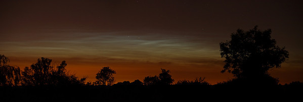 18 June 2010. The 2010 Noctilucent season has begun. First decent sightings of the year from the early hours of this morning (0100hrs) in Lutterworth, Leics. Not a bad dispaly which lasted for about an hour. Night turned to day for a brief period. Captured with Olympus E3, 50-200mm. F3.2, 10s, ISO 200. Panorama stitch of 3 mages.