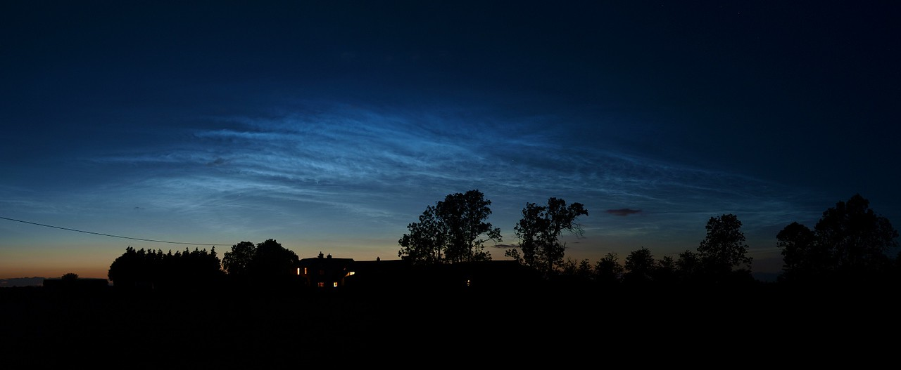 Midnight darkness turns to day from the glow of noctilucent clouds captured above the Leics skyline on June 17/18th 2009. 