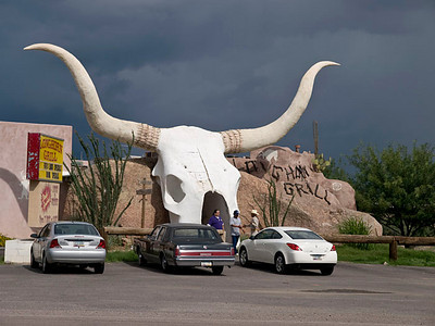 The Longhorn bar and grill, Arivaca, Tucson, Arizona. It's not every day you get to see a place like this. The iconic horns are visible for miles and it's an irresistible stop. The food is as good as the entrance.  Olympus E3, 7-14mm