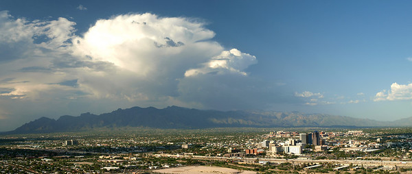 A home grown storm springs into life over downtown Tucson. Storms would fire up in minutes over the Catalina range and end up drifting over the city. It made for great photos. A good vantage point was crucial to capture such a scene. This was taken from 'A' mountain, just across the Interstate west of Tucson, a great place to sit and watch the storm erupting.  Olympus E3, 12-60mm SWD - F6.3, 1/250s