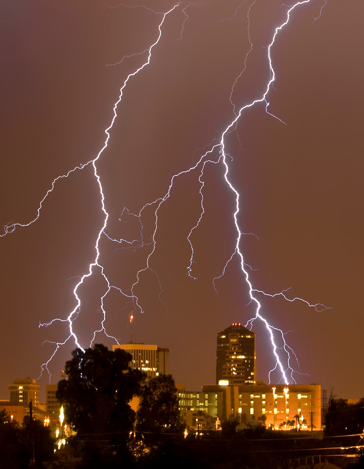One of my objectives in Arizona was to capture quality lightning exploding over a city landscape. Mission accomplished. I recall leaping in the air screaming with joy after catching this beauty.  Olympus E3, 50-200mm SWD - F5.6, 40s