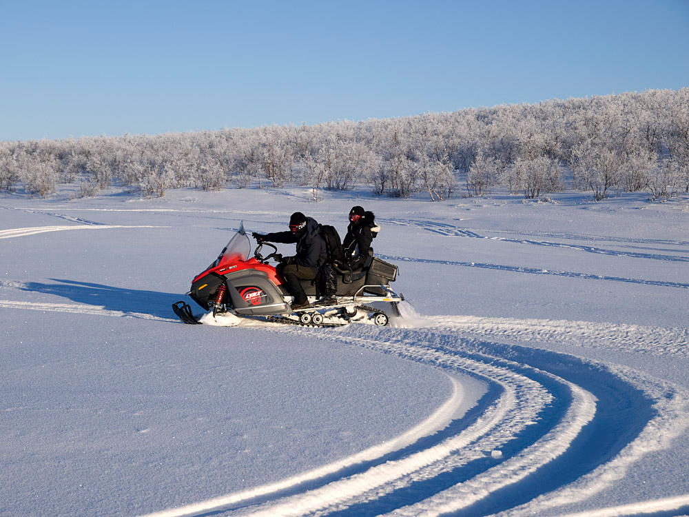 Me and Deb on skidoo on frozen lake at back of camp.