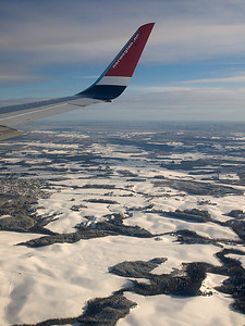 View from Norwegian airspace as we approach Oslo. Lots of snow on ground in Oslo, unusually so apparently. It was -15C here. Nice & short 2 hr flight although space was designed around chicken legs. Olympus E510, 14-42mm