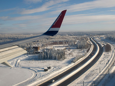 View from Norwegian airspace as we approach Oslo. Lots of snow on ground in Oslo, unusually so apparently. It was -15C here. Nice shot of the main highway. Note its open and running! Olympus E510, 14-42mm