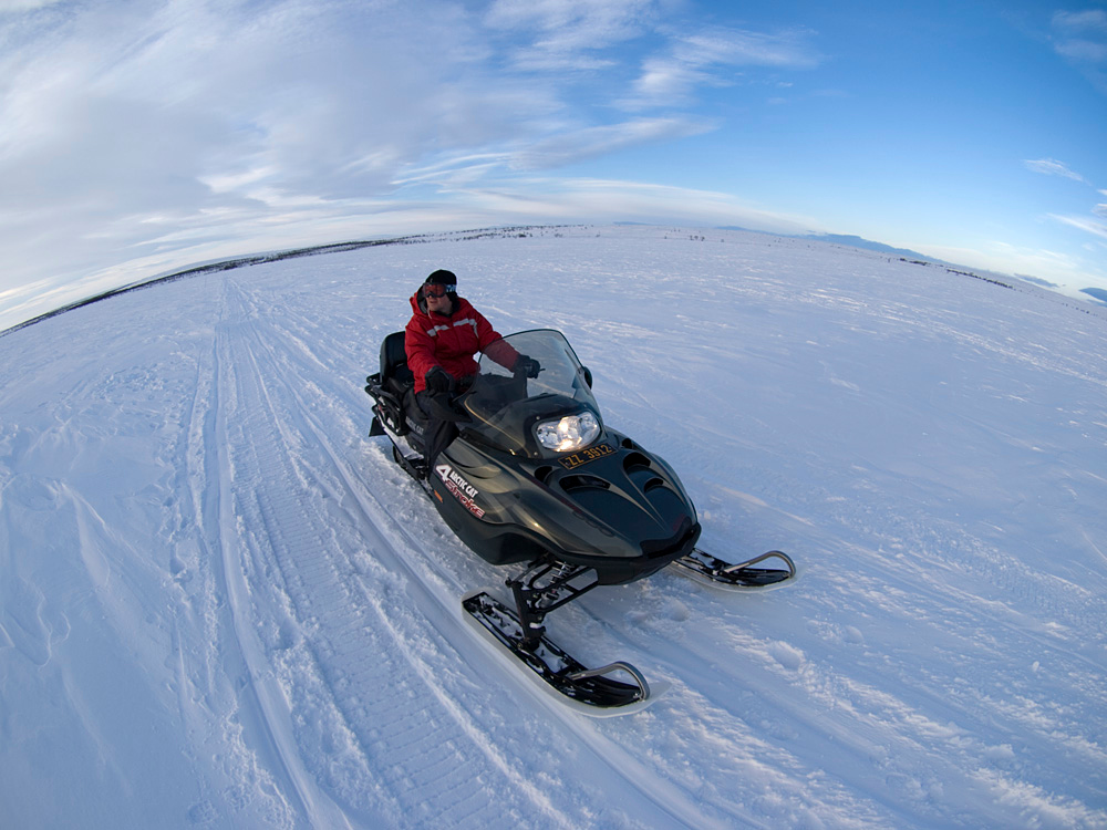 Scooter. 200 miles above the 66 degree latitude (Arctic circle). Deep in the northern territories of Finnmark and just outside the small Sami town of Karasjok. Our base camp was only accessible vis snow scooter. It took 30 mins to reach camp from the highway and was our means of transport during the trip. Great fun, enabling us to cover plenty of ground in search of good photo shoot locations. Had a scare on the first day as we ventured out and managed to roll one in very deep snow. Took  ages to get back on track. Not a good start.  Olympus E3, 8mm fisheye - F4, 1/400s, EC +0.7