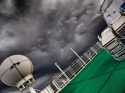 April 29 2011. In the med between Gilbraltar and SE Spain. Could not resist the stormy sky at the end of the day. Looked great combined with the colours of the ship deck using the Oly E5 dramatic tone art filter.