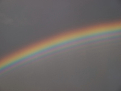 July 23 2009, a day full of storms and great bows. Captured this nice close up detailing the supernumery (faint rainbow on inner side of primary). Olympus E3, 12-62mm SWD lens.