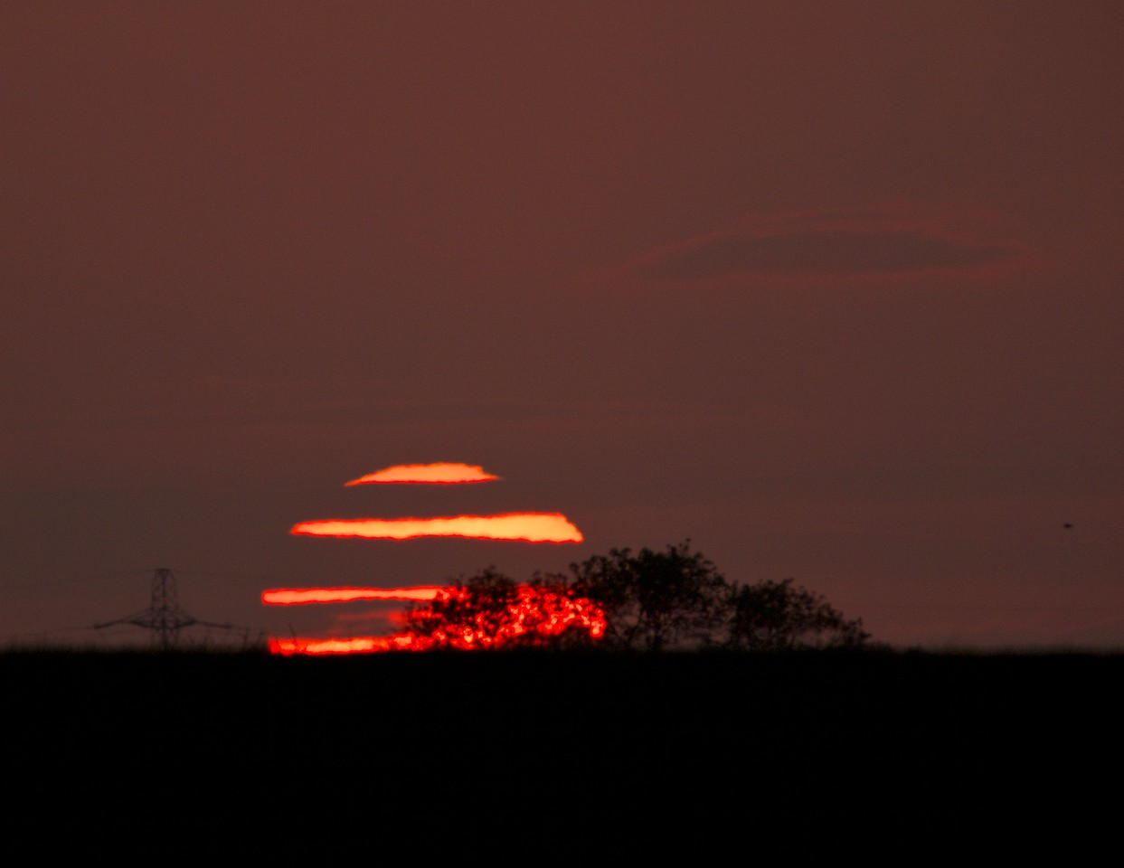 May 18 2011. Nice sunset tonight. Clouds & frontal system cleared through early evening paving the way for clear skies. Hopped into a local field and upped the focal length with the 90-250mm & x2TC, netting a 500mm (1000mm equiv 35mm) focal length. The low level strata cloud cover actually made the shot.