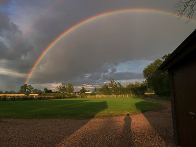 23 July 2009. Great day for home grown storms in Leics, UK. Some wonderful rainbow opportunities which I captured with my Olympus E3, 12-62mm SWD lens. Normally self shadows are a big no-no, however, loved the primary and secondary bows framing my shadow in this case.