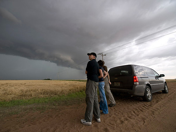 A team of stormchasers watching a supercell storm. There was some great structure in this storm and I hung around a good few minutes behind my team waiting for a look or turn, something to bring across the human factor in the frame.