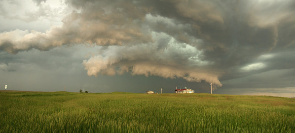 The storm produced some famtastic structure including a great wall cloud. Many funnels teased us with touchdown but none visibly made it. I found a great spot for a few photos with a very photogenic 'Little house on the Prairie' in the foreground. I watched the wall cloud roll straight over it and funnels galore dropped right over the house. Nebraska USA. Olympus E1, 14-54mm
