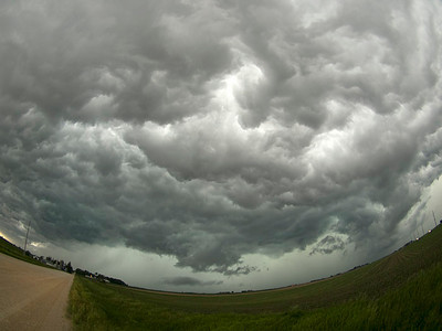 Wild skies, known as a whales mouth - Cold downdraft air from the storm surges forward and lifts the warmer air. This creates a very turbulent looking sky with mammatus looking features.