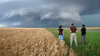 A team of stormchasers watching a supercell storm. There was some great structure in this storm and I hung around a good few minutes behind my team waiting for a look or turn, something to bring across the human factor in the frame. The young lady duly obliged and I had my shot.  Olympus E3, 12-60mm SWD - F5.6, 1/10s