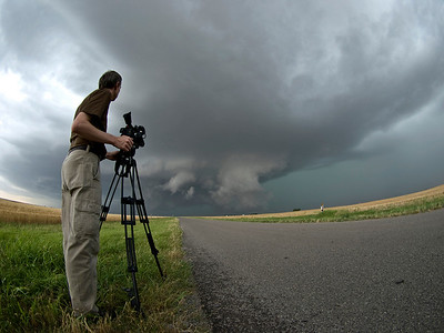 This supercell we captured in Oklahoma was very photogenic. If a tornado is going to form this is exactly where it will happen. I was using the 8mm fisheye to frame Al filming, in an attempt to throw a different angle on the subject. It worked well. The image tells a story from that moment in time, which was my aim.  Olympus E3, 8mm fisheye - F4.5, 1/20s