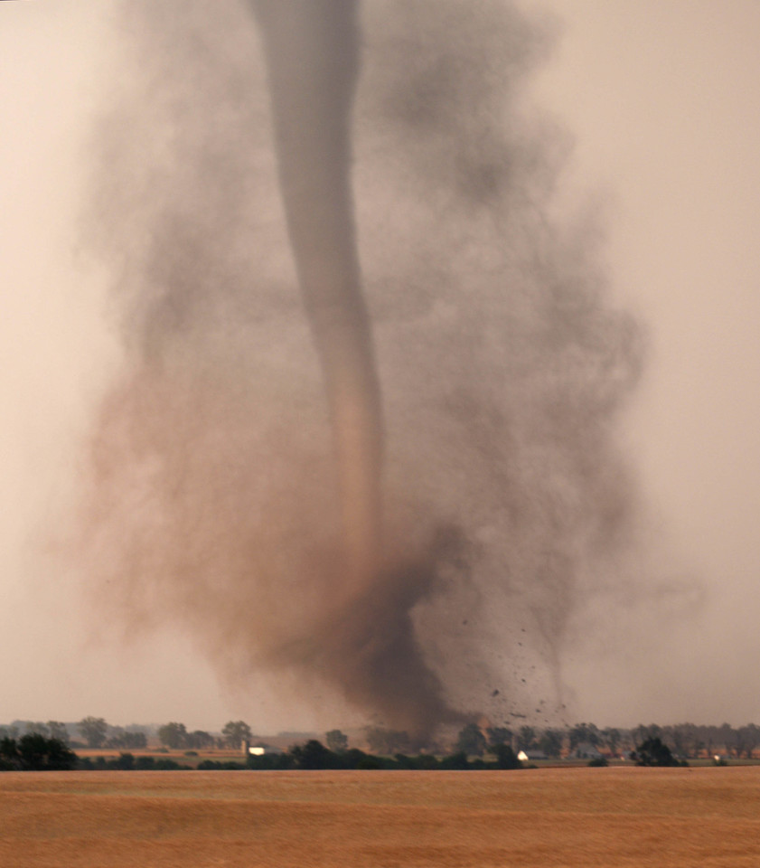 Stunning tornado on ground at Harper, Kansas, USA. Damage to farm buildings evident.